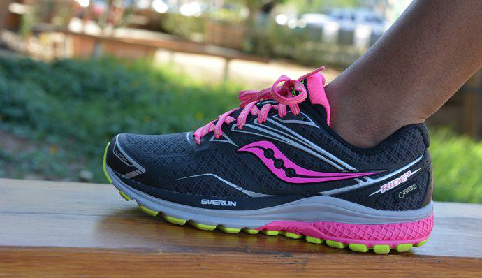Female stands in Saucony Ride 9 GTX® Shoe