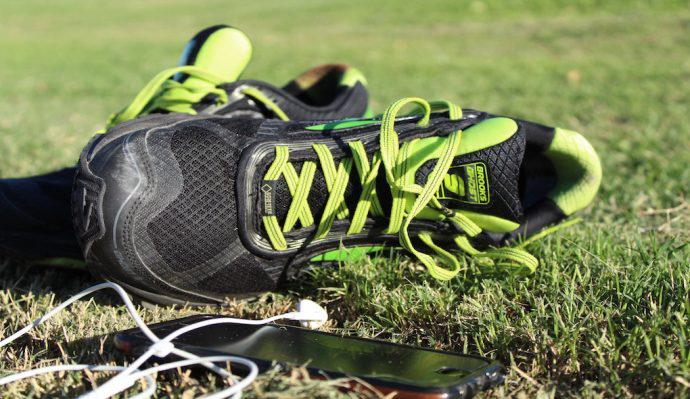 Brooks Ghost 9 GTX® Shoes pictured in grass next to iPhone and headphones