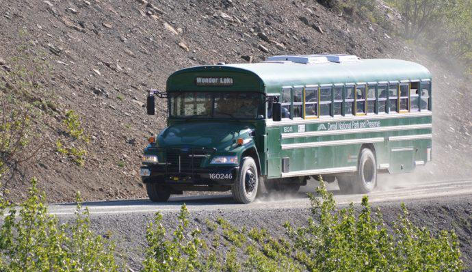A bus riding down the road in Denali National Park