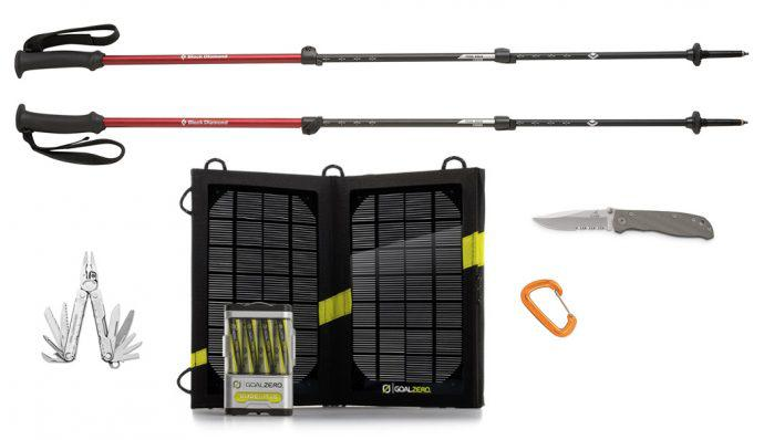 An image of a solar panel charger, Black Diamond trekking poles, a multi-tool, and a folding knife