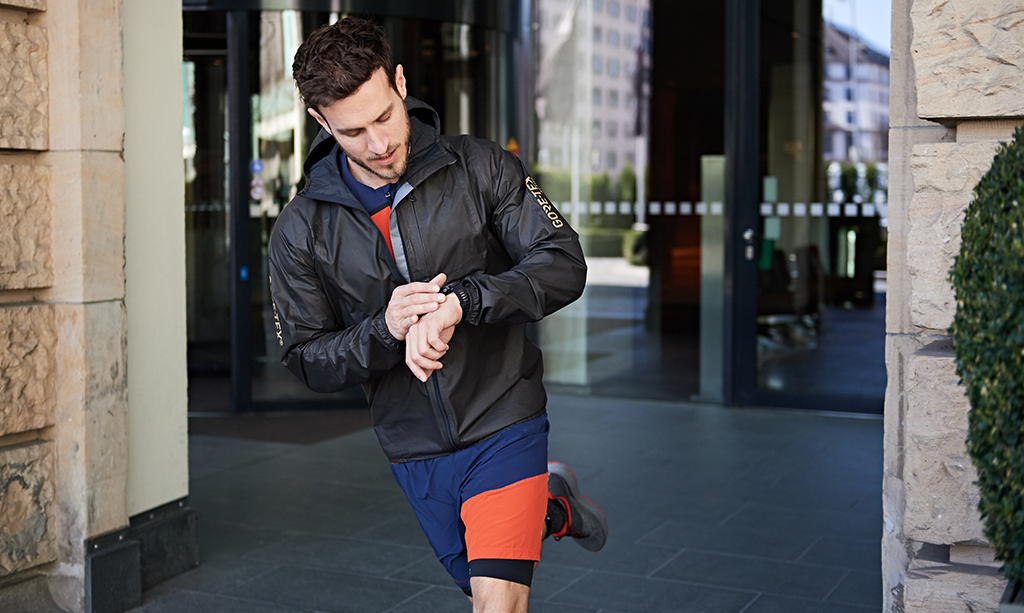 man on business going to run in shakedry jacket