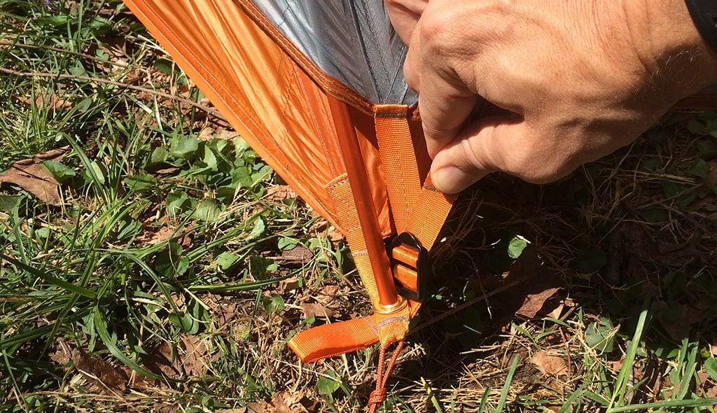 adjust tension on corners of tent